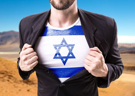 dry suit: Businessman stretching suit with Israel flag on desert background Stock Photo