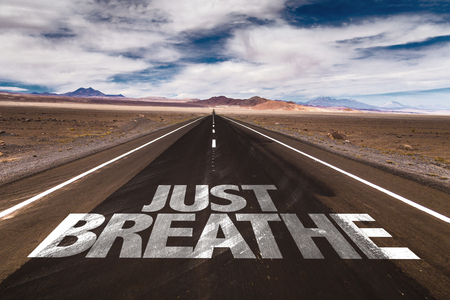 breathe easy: Just breathe written on the road