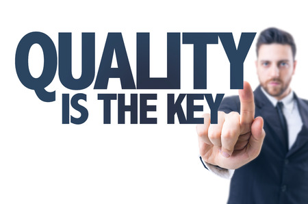 commitment committed: Business man pointing the text: Quality is the key