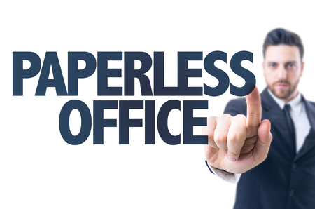 paperless: Business man pointing the text: Paperless office Stock Photo