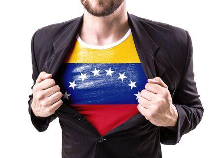 venezuela flag: El hombre de negocios traje de estiramiento de la bandera de Venezuela en el fondo blanco Foto de archivo