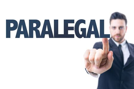 paralegal: Business man pointing the text: Paralegal Stock Photo