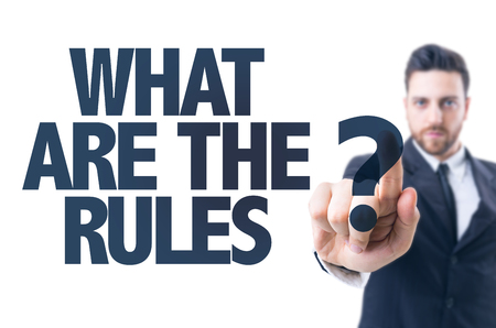 Business man pointing the text: What are the rules? Stockfoto