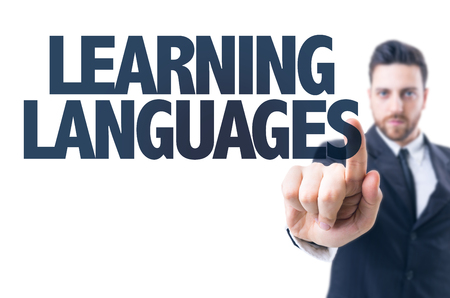 Business man pointing the text: Learning languages