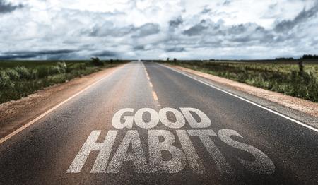 good habits: Good habits written on the road Stock Photo