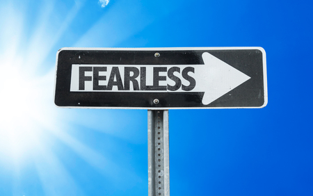 unafraid: Fearless sign with arrow on sunny background