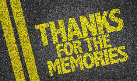 Text on tar road: Thanks for the memories Stock Photo