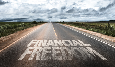 Financial freedom written on the road Imagens