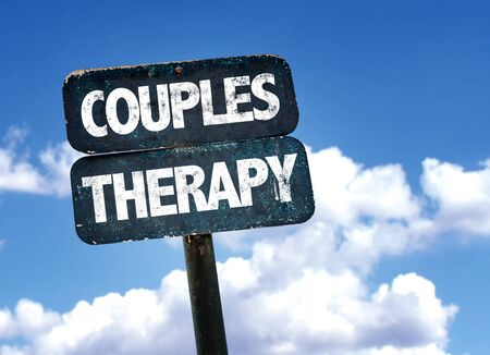 couples therapy: Couples therapy written on the road sign with clouds and sky background