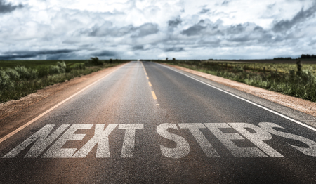 next: Next steps written on the road
