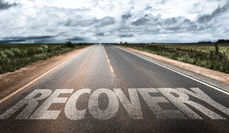 road to recovery: Recovery written on the road Stock Photo