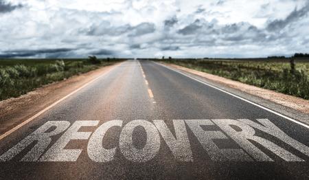 Recovery written on the road Foto de archivo
