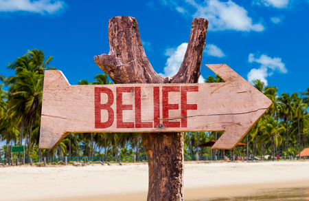 Belief sign with arrow on beach background