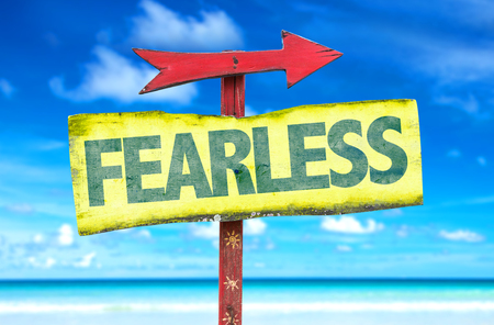 unafraid: Fearless sign with arrow on beach background