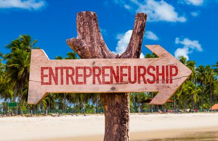 Entrepreneurship sign with arrow on beach background