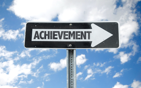 Achievement sign with arrow on sunny background Stock Photo