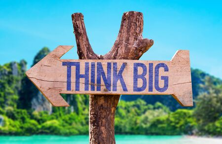 big sign: Think big sign with arrow on beach background Stock Photo