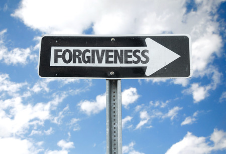 forgiven: Forgiveness sign with arrow on sunny background