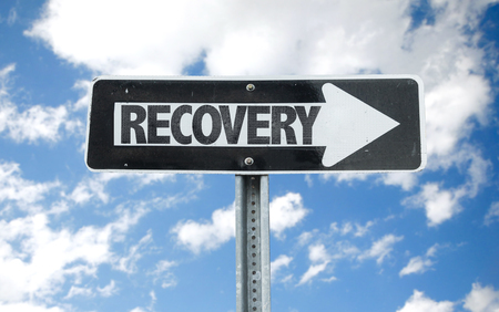 recovery: Recovery sign with arrow on sunny background Stock Photo