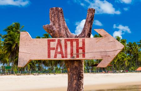 trust god: Faith sign with arrow on beach background