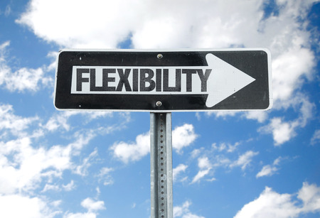 accommodating: Flexibility sign with arrow on sunny background