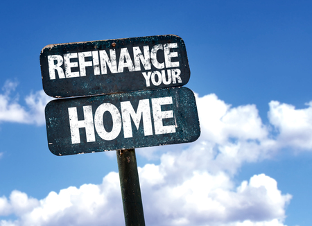 lender: Refinance your home written on the road sign with clouds and sky background