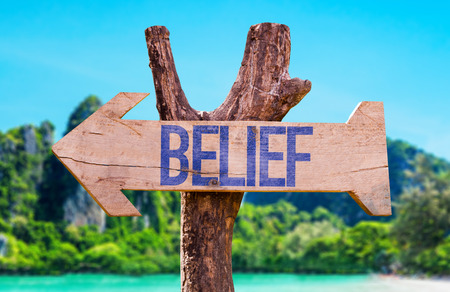 personal perspective: Belief sign with arrow on beach background