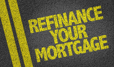 Text on tar road: Refinance your mortgage