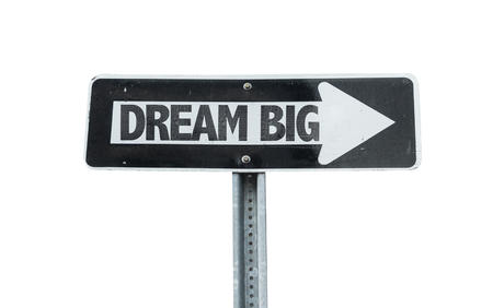 envision: Dream big sign with arrow on white background