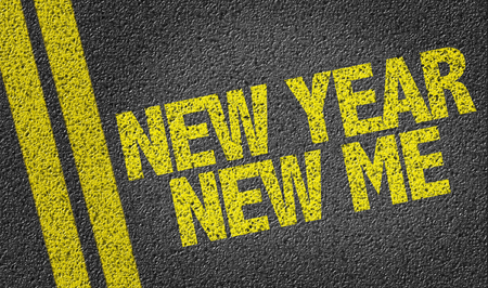 Text on tar road: New year new me Stock Photo