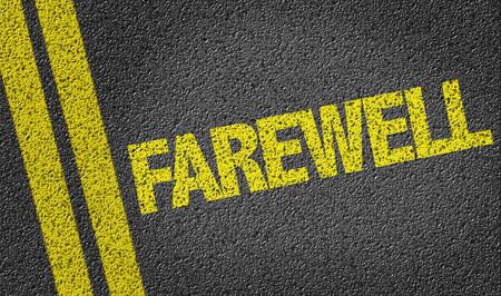farewell: Text on tar road: Farewell Stock Photo