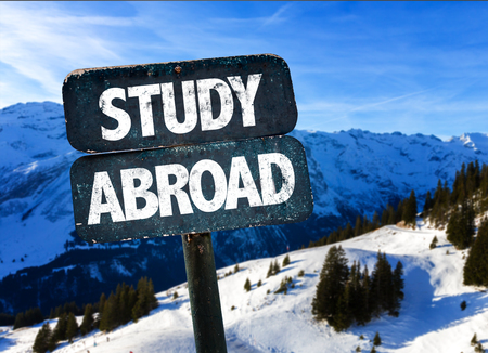 Study abroad sign with outdoors background Stock Photo