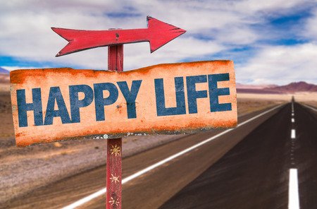 Happy life sign with arrow on a highway background