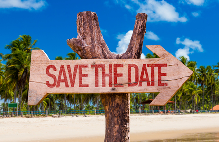 Save the date sign with arrow on beach background