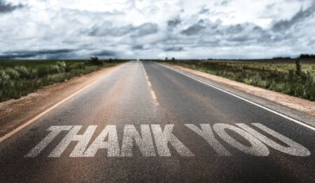 courteous: Thank you written on the road