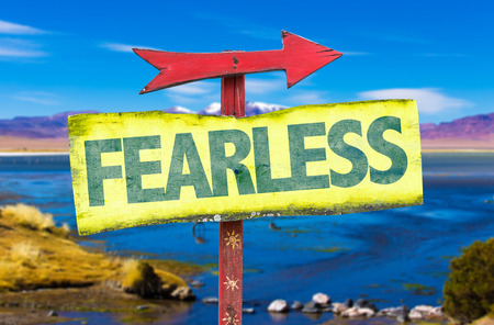 fearless: Fearless sign with outdoors background Stock Photo