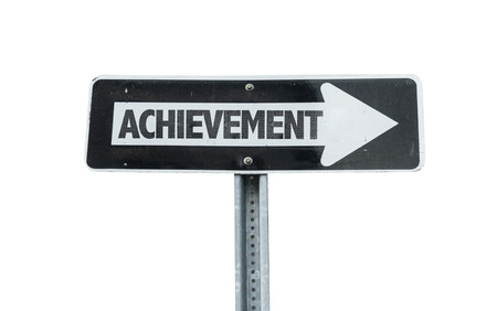 attainment: Achievement sign with arrow on white background Stock Photo