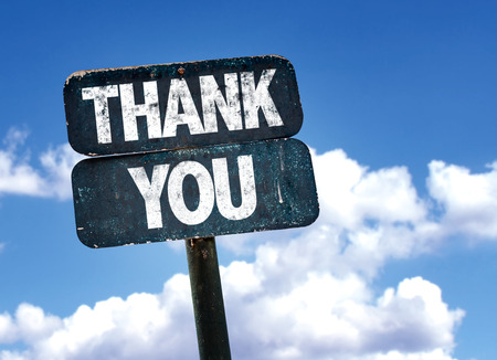 courteous: Thank you written on the road sign with clouds and sky background Stock Photo