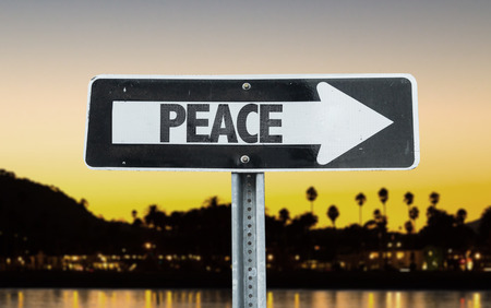 redemption of the world: Peace sign with arrow on sunset background
