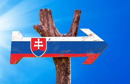 slovakia flag: Slovakia flag sign with arrow on sunny background