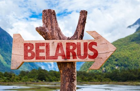 Wooden sign board in wetland with text: Belarus
