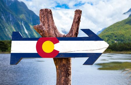 colorado flag: Colorado flag sign with arrow in wetland background Stock Photo