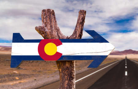 colorado flag: Colorado flag sign with arrow on road background