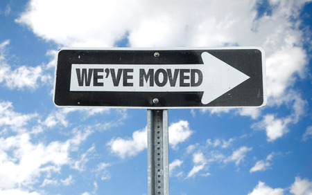 We've moved sign with arrow on sunny background