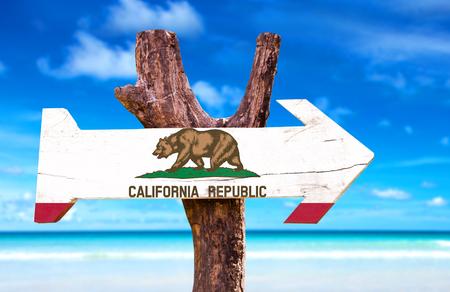 california flag: California flag sign with arrow on beach background