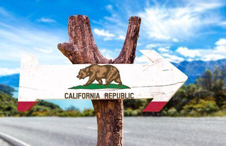 california flag: California flag sign with arrow on road background