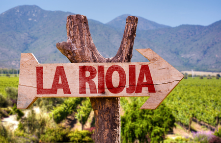 Wooden sign board in park with text: La Rioja