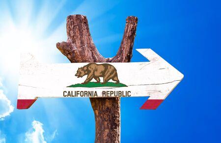 california flag: California flag sign with arrow on sunny background Stock Photo