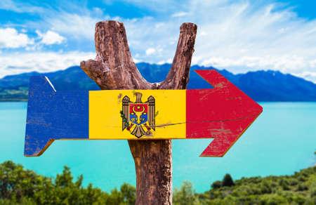 Moldova flag wooden sign board in wetland background