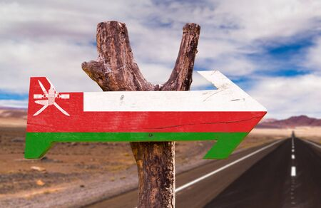 Oman flag sign with arrow on road background Stock Photo